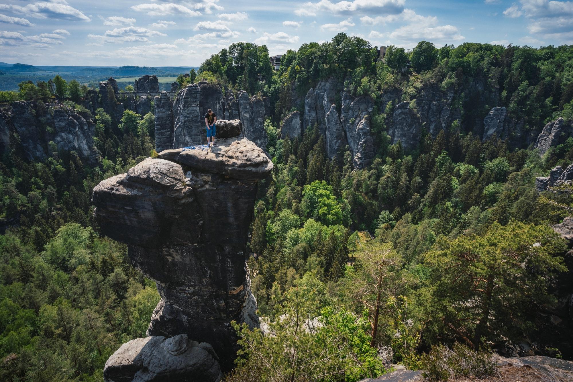 Ferdinandstein with unrecognized climber in famous Bastei national park Saxon Switzerland, Germany
